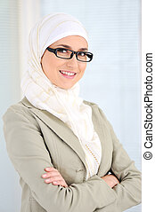 Muslim business woman in office