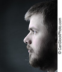 Portrait of young man with beard
