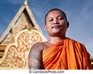 portrati of buddhist monk near temple, Cambodia, Asia - Mid...