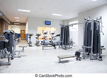 Fitness club gym with sport equipment interior - Fitness...