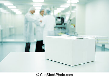 White box at automated production line at modern factory -...