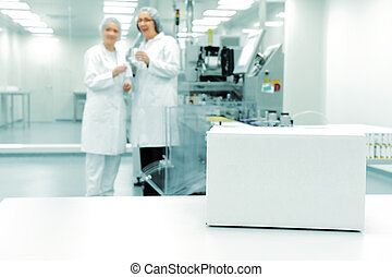 White box at automated production line at modern factory