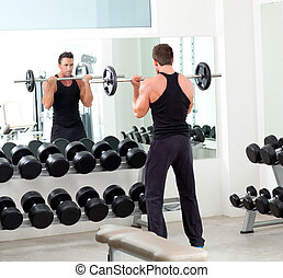 man with dumbbell weight training equipment gym - man with...