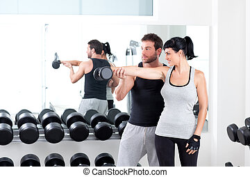 gym woman personal trainer with weight training - gym woman...