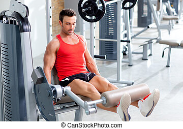 man lifting weights with a leg press on sport gym club