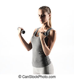 Woman lifting weights - A beautiful woman raises with...