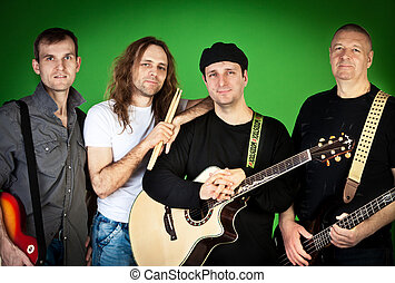 Musical group of artists on a green background