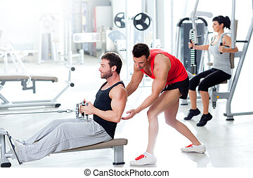 gym man with personal trainer and fitness woman