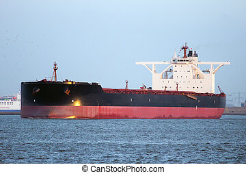 Large tanker - Large oil tanker leaving Rotterdam harbor at...