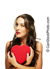 beautiful woman with red lipstick holding red heart on white background