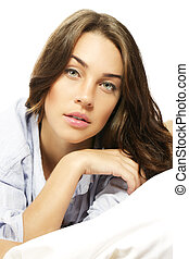 brunette woman in bed on white background