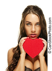gorgeous brunette woman holding red heart on white background