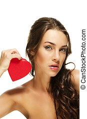 gorgeous woman holding red heart on white background