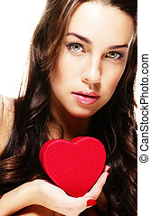 cute brunette woman holding red heart on white background