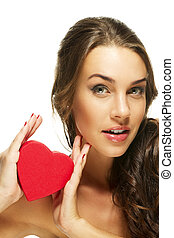beautiful woman presenting red heart on white background