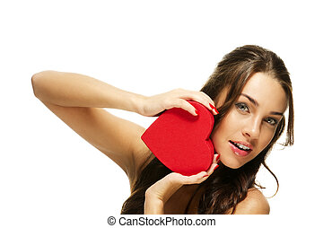 amazing beautiful woman holding red heart on white background