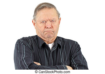 Grumpy old man - Senior man with arms crossed looking very...