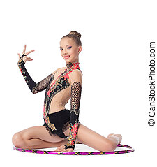 Young girl gymnast sit with hoop isolated - Young beautiful...