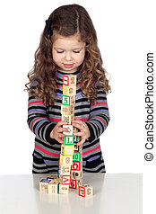 Adorable baby playing with wooden blocks isolated over white...