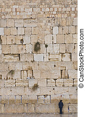 The Western wall - Orthodox Jew prays in the Westren wall an...