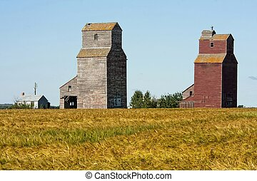 Pair of Grain Elevators - Two old grain elevators remain in...