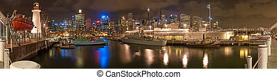 Darling Harbour in Sydney, night panorama photo with HMAS...