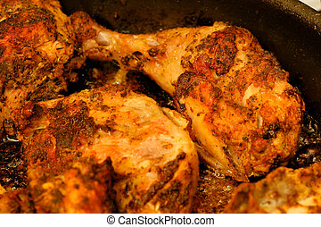 Roasted chicken on pan.