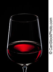 red wine in glass isolated on black