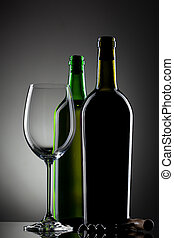 empty wine glass and bottles