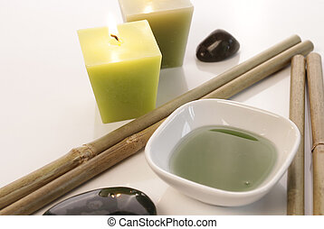 Bath additive with bamboo - Spa background with candles and...