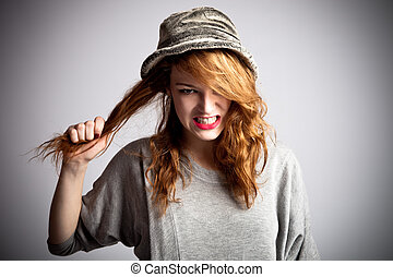 bad hair day - young red hair woman displeased with her...