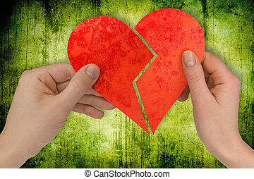 love and divorce two hands holding broken heart