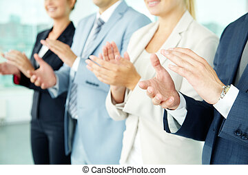 Success - Photo of business partners hands applauding at...