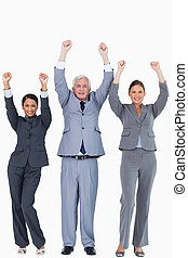 Three businesspeople with arms up
