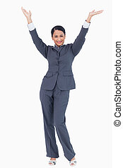 Cheering businesswoman against a white background