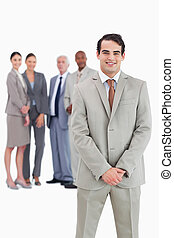 Businessman with team behind him