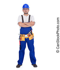 Confident repairman with lots of tools