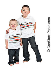 Brothers - little Brothers standing together on white...