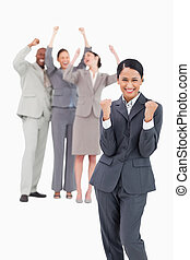 Successful saleswoman with cheering team behind her -...