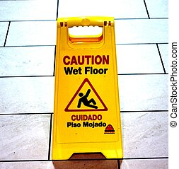 "WET FLOOR SIGN - A ""wet floor"" sign with floor tiles in the..."