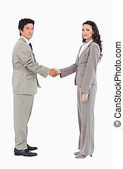Side view of trading partners shaking hands