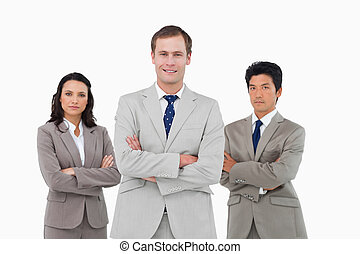 Confident young business team with arms folded