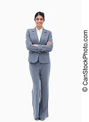 Smiling businesswoman with her arms folded