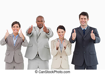 Sales team giving thumbs up against a white background