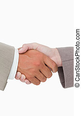 Side view of shaking hands closing a deal