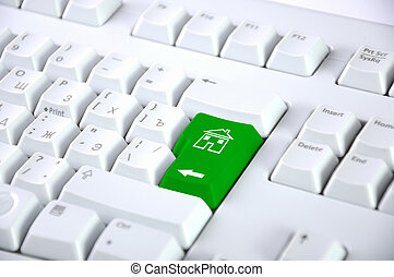 Computer keyboard with house symbol on it