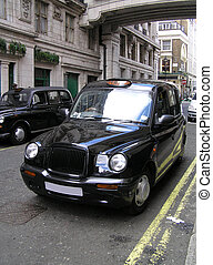 Classic London Cab - Classic London cab on the street.