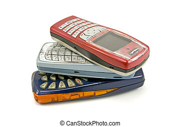 used old Cell phones on white background