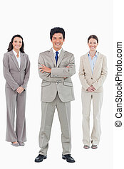 Smiling businessman with his staff behind him
