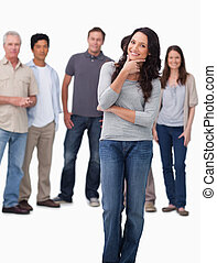 Woman in thinkers pose with friends behind her